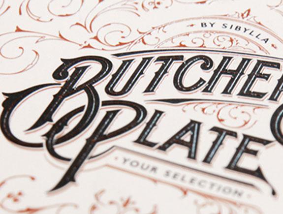 primer logotipa butchers plate na specijalnoj vrsti papira